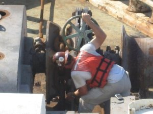 """Ultra-Stud"" Ferris of AMSI. See him down there HAND-BREAKING the bow anchor as she's lowered down...yes, I said HAND-BREAKING...un-freakin-real!! Even Thom and Ray developed admitted ""man-crushes"" on him that morning...LOL! -- Pict and commentary by Stacey Loiseaux"