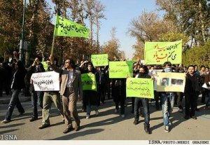 "Iranian students in Tehran carry signs reading ""We want democracy! ISNA"